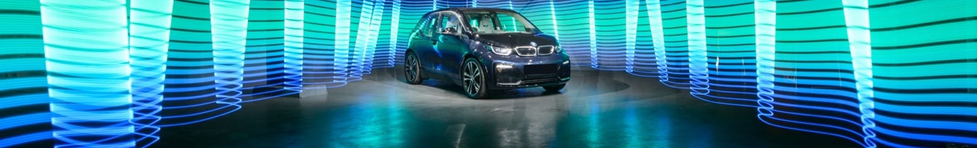 hybrid electric car surrounded by blue and green light