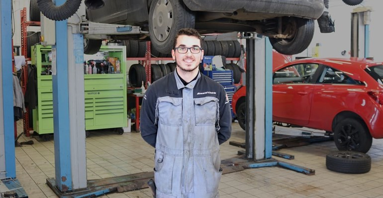GTG Apprentice Harry in front of car ramp