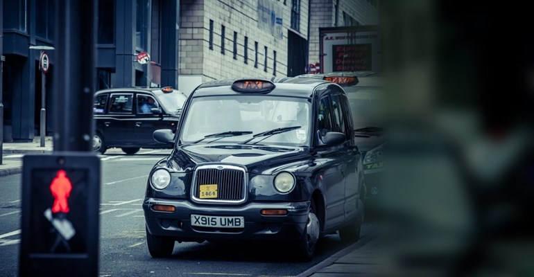 Black cab in city street